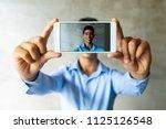 portrait of smiling businessman ...   Shutterstock . vector #1125126548