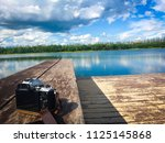 relax corner and lake view with ... | Shutterstock . vector #1125145868