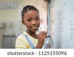 african student girl doing math ...   Shutterstock . vector #1125155096