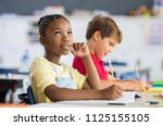 thoughtful elementary school... | Shutterstock . vector #1125155105