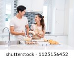 asian couples cooking and... | Shutterstock . vector #1125156452