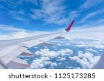 wing of an airplane flying...   Shutterstock . vector #1125173285