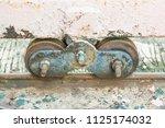 old slide door with wheel... | Shutterstock . vector #1125174032