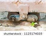 old slide door with wheel... | Shutterstock . vector #1125174035
