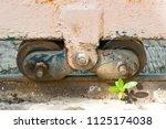 old slide door with wheel... | Shutterstock . vector #1125174038