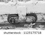old slide door with wheel... | Shutterstock . vector #1125175718