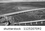 aerial view of broken bridge... | Shutterstock . vector #1125207092