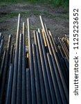oil drill pipe. rusty drill... | Shutterstock . vector #1125223652