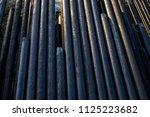 oil drill pipe. rusty drill... | Shutterstock . vector #1125223682