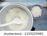 chef put cooked rice with... | Shutterstock . vector #1125225482