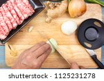 chef cutting onion before... | Shutterstock . vector #1125231278