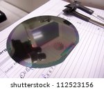 silicone wafer and the tweezers | Shutterstock . vector #112523156