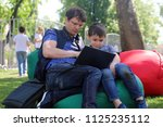 the father trains the son to...   Shutterstock . vector #1125235112