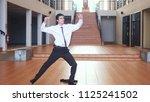 young happy handsome... | Shutterstock . vector #1125241502