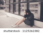 asian woman sitting alone and... | Shutterstock . vector #1125262382