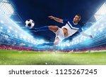 soccer striker hits the ball... | Shutterstock . vector #1125267245