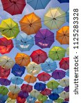 colorful umbrellas on the sky... | Shutterstock . vector #1125283328