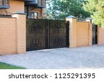 black forged automatic gates in ... | Shutterstock . vector #1125291395