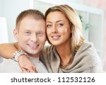 happy couple looking at camera | Shutterstock . vector #112532126