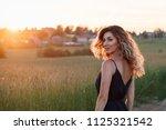 russian beauty  in a black...   Shutterstock . vector #1125321542