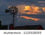 texas skies with windmill and...