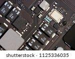 laptop microcircuits close up.... | Shutterstock . vector #1125336035