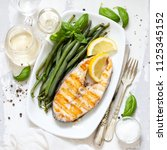grilled perch with green beans... | Shutterstock . vector #1125345152