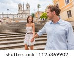 happy romantic couple holding... | Shutterstock . vector #1125369902