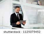 handsome middle age businessman ... | Shutterstock . vector #1125375452