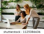 cheerful professional... | Shutterstock . vector #1125386636