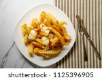 canadian poutine crinkle cut... | Shutterstock . vector #1125396905