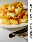 canadian poutine crinkle cut... | Shutterstock . vector #1125396935