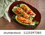 zucchini stuffed with meat ... | Shutterstock . vector #1125397385