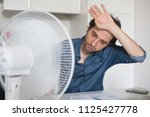 sweaty man trying to refresh... | Shutterstock . vector #1125427778