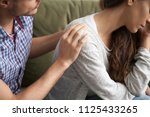 helping caring husband... | Shutterstock . vector #1125433265