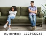 frustrated millennial couple... | Shutterstock . vector #1125433268