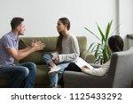unhappy couple arguing having... | Shutterstock . vector #1125433292