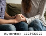 Small photo of Close up view of couple holding hands, loving wife supporting or comforting husband ready to help expressing sympathy, encouraging and understanding in marriage relationships, reconciliation concept