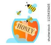sweet honey in a glass bowl... | Shutterstock .eps vector #1125435605