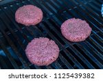 hamburger on grill grilling... | Shutterstock . vector #1125439382
