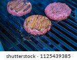 hamburger on grill grilling...   Shutterstock . vector #1125439385