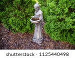 francis of assisi statue... | Shutterstock . vector #1125440498