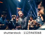 shot of a young man dancing in... | Shutterstock . vector #1125465068