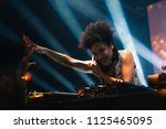 young dj touching a hand in the ... | Shutterstock . vector #1125465095