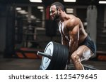 brutal strong bodybuilder... | Shutterstock . vector #1125479645