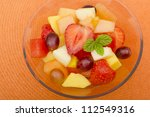 Fruit Salad - A colourful variety of fruit in a glass bowl. Refreshing light meal! - stock photo