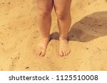 legs of young sunburnt kid on a ... | Shutterstock . vector #1125510008