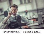 worried young entrepreneur... | Shutterstock . vector #1125511268