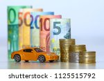 blurred row of rolled hundred ... | Shutterstock . vector #1125515792