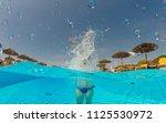young woman enjoying in the... | Shutterstock . vector #1125530972
